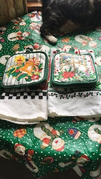 two green-and-white Christmas decor-themed blankets
