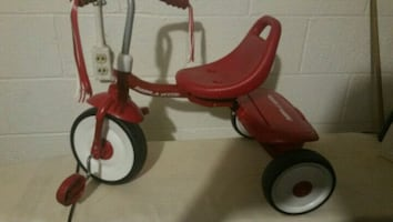 red and white Radio Flyer tricycle