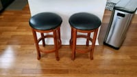 two brown wooden framed black leather padded stools Hanover, 21076