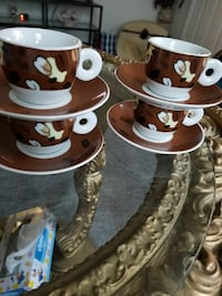 brown and white ceramic cup and saucers