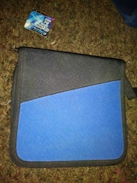 blue and black fabric zip wallet