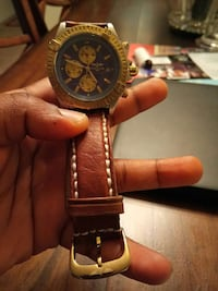 round black chronograph watch with brown leather strap Gaithersburg, 20879