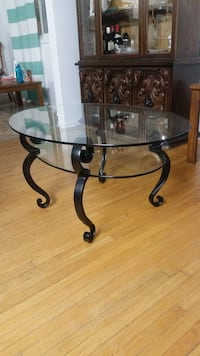 Oval / Round glass-top table with black steel base