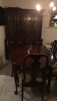 Cherry dining room table with two arm  chairs, four side chairs and china closet Downingtown, 19335