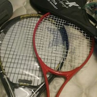 two red and black tennis rackets Guelph, N1G 3K4