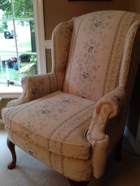 Beige floral padded armchair