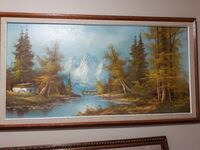 white mountain and green trees painting with brown wooden frame