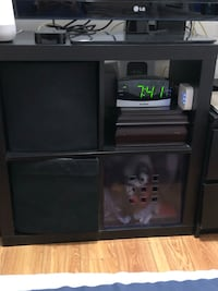 black wooden TV stand with flat screen television Vancouver, V5R