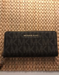 Black and Brown Michael Kors leather long wallet.Negotiable.