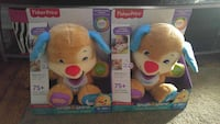 two Fisher-Price Laugh and Learn Dogs puppy with boxes