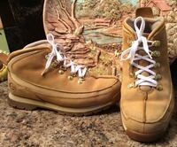 pair of brown Timberland leather high cut shoes
