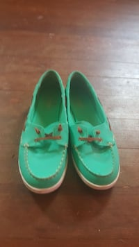 pair of green-and-white boat shoes