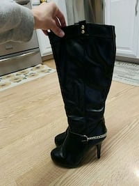 pair of black leather knee-high boots Omaha, 68157