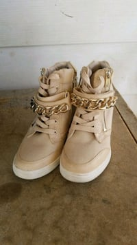 pair of beige high-top sneakers Edmonton, T5C 1N4