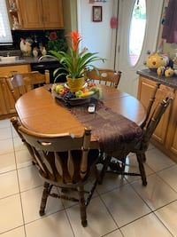 Solid wood table with 4 chairs plus 4 bar height chairs Arlington Heights