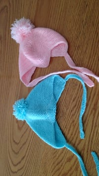 Baby's blue and pink knitted caps. 8$ a peice  Camrose