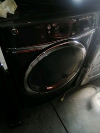 GE front loading washer & dryer set with base drawers