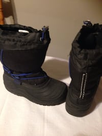 pair of black snow boots