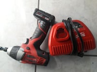 red and black Milwaukee impact driver with battery charger Sterling, 20164