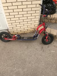 red and black kick scooter Steinbach, R5G 0X6