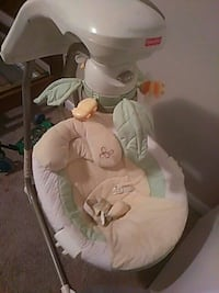 Green and white Fisher-Price Cradle'n Swing