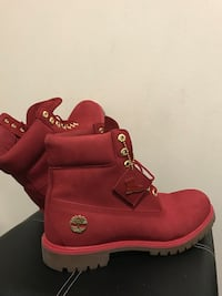 pair of red Timberland boots Mississauga, L4T 3T6