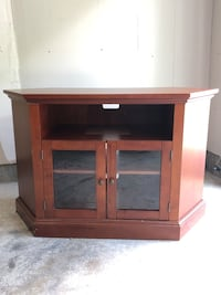 TV console with two shelves and glass doors