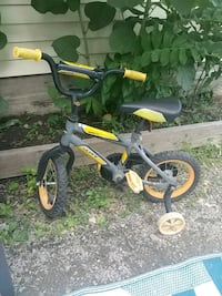toddler's yellow and black trike Hamilton, L0R 1K0