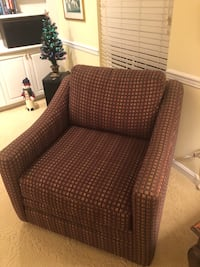 Armchair 2 years old. Brown with blue green yellow rust pattern