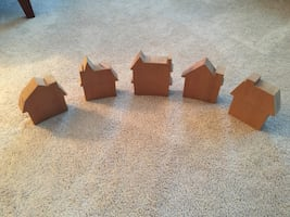 Set of five wooden house cut outs.