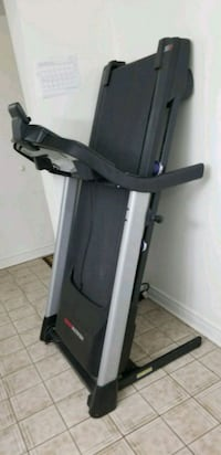 black and gray automatic treadmill