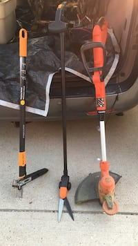 red electric string trimmer and two equipment Calgary, T3H 3L5