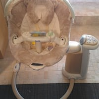 baby's brown and white bouncer Calgary, T2E