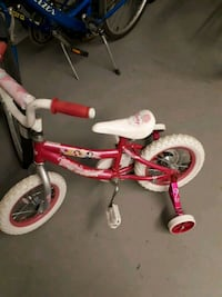 toddler's red and white bicycle with training whee Port Moody