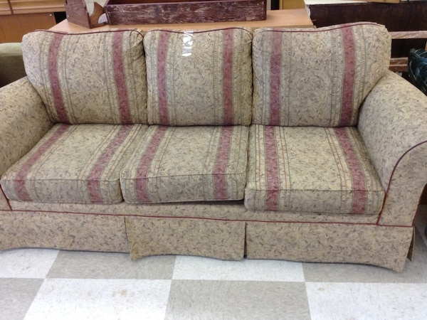 gray and red floral 3-seat sofa