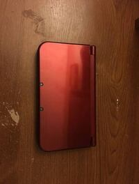 Red Nintendo DS XL with game 2394 mi