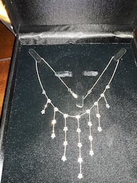 flower accent silver-colored necklace