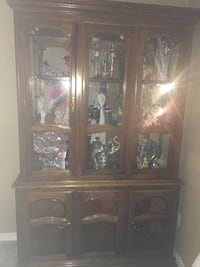 brown wooden framed glass display cabinet Colorado Springs, 80923