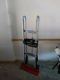 gray and red hand truck