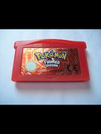 red and black Pokemon game cartridge 3156 km