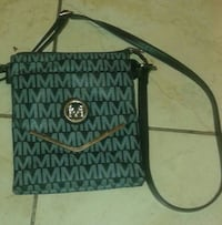 monogrammed gray and black Michael Kors leather crossbody bag