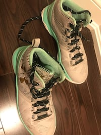 pair of brown-and-green Under Armour basketball shoes Toronto, M6C 2E5