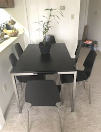 Rectangular black wooden table with six chairs dining set. Price as marked. Fairfax, 22030