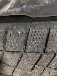 4 18 inch 100mm bolt pattern rims with 2 close to new winter tires Stratford, N5A 1J8