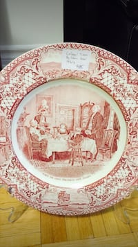 round red and white ceramic plate