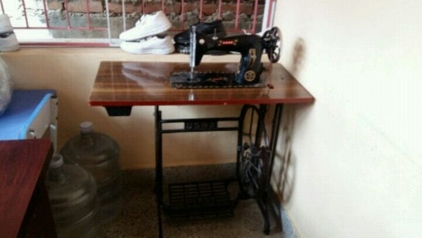 brown and black treadle sewing machine