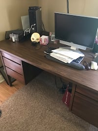 Solid Wood Desk with Laminated Top to protect from dings and rings. Roller Bearing Drawers. Has Built in File Cabinet, 2 Small Drawers and 2 Regular Drawers. 6ft. Wide and 3ft Deep. Sits on 4 Legs, so it's easier to move around. See pictures. Pickup in Ca Castle Hayne, 28429