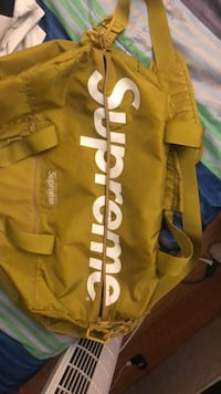 yellow and white Adidas duffel bag 551 km