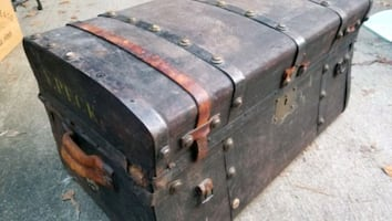 Antique leather and metal bound wooden steamer trunk