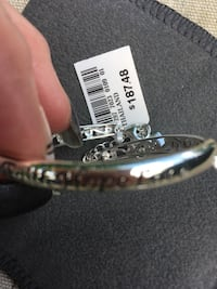 Jewelry purchased at JCPenny Sterling Silver Bracelet; tag is still attached Excellent condition Bedford, 47421